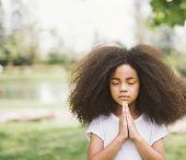 Afro Child Praying. Black Kid Prays. Gesture Of Faith.hands Folded In Prayer Concept For Faith,spiri poster