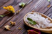 Spa Concept: Composition Of Spa Treatment With Natural Sea Salt, Aromatic Oil And Flowers On Wooden  poster