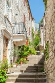 Narrow Stairs Alley With Residential Masonry Houses In Hvar, Croatia. poster
