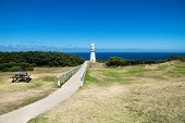 Cape Otway Lighthouse In Grasslandpark With Bench And Overlook At The Ocean At The Great Ocean Road, poster