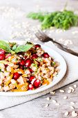 Plate Of Pearl Barley Warm Salad With Carrot, Dill And Pomegranate Seeds In A Plate On A Wooden Tabl poster