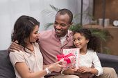 African American Daughter And Husband Presenting Gifts To Wife On Mothers Day poster