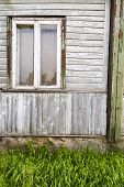 Old Window On A Aged Wooden Wall. Architectural Detail. Architecture Background. poster