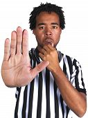 pic of umpire  - young male African American referee gesturing a generic play sign - JPG