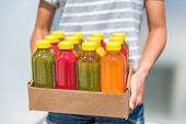 Bottles of juice with fruits and vegetables in delivery box. Cold pressed juicing bottles. Healthy j poster