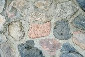 Texture Of A Gray Stone Wall. Old Wall Stone Wall As A Background. Part Of A Stone Wall, For A Backg poster