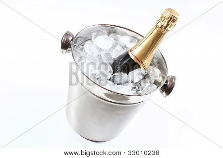 Champagne flutes and ice bucket isolated in studio