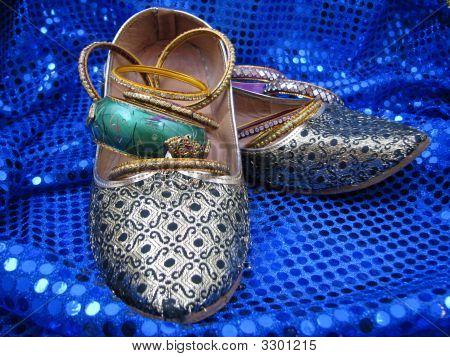 India Shoes And Bangles On Blue Sequin
