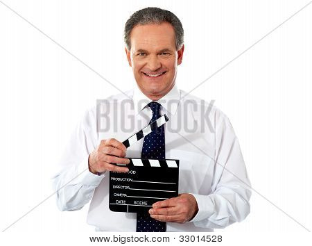 Aged Corporate Male Holding Clapperboard