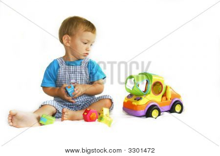 Baby Boy Playing With Toy-Truck