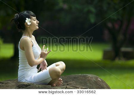 Beautiful Asian Woman Meditating Outdoor