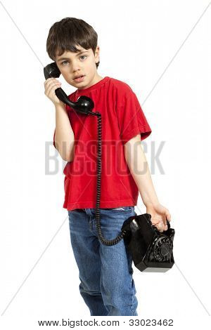 portrait of little boy on the phone, isolated on white background