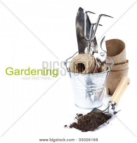 garden tools (shovel,  rake, pruner, garden string and peat pots ) over white (with easy removable text)