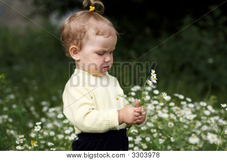 Baby-Girl And Flowers