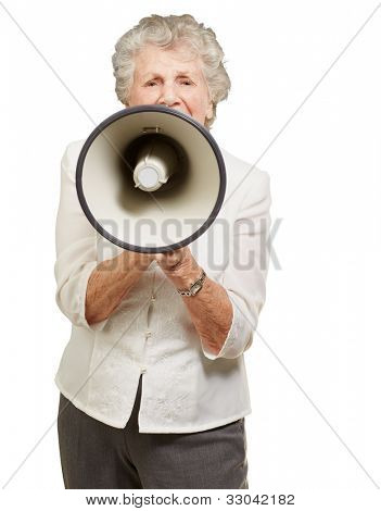 portrait of a senior woman screaming with a megaphone over a white background