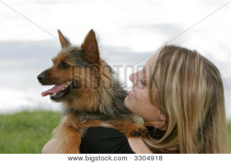 Woman And Dog In The Park