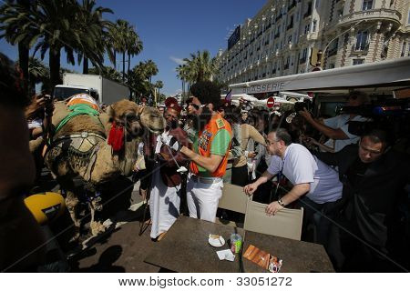 CANNES - MAY 16: Sacha Baron Cohen dressed as the character Admiral General Aladeen from 'The Dictator' at the 65th Annual Cannes Film Festival on May 16, 2012 in Cannes, France