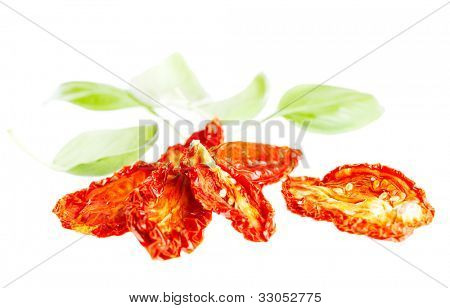 sun-dried tomatoes with basil leaves, isolated on white