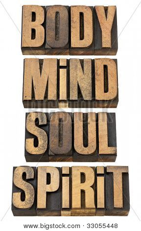 body, mind, soul and spirit - a collage of isolated words in vintage letterpress wood type