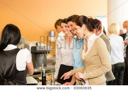 Paying at cafeteria woman cashier serve woman food and drinks