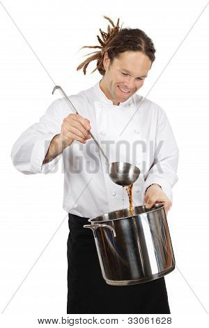 Chef Preparing Soup In Large Pot