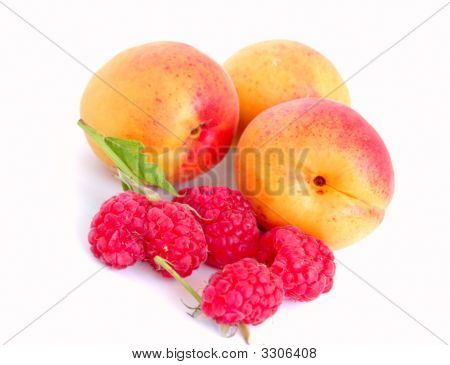 Close-Up Of Raspberry And Apricots