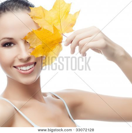 portrait of attractive  caucasian smiling woman isolated on white studio shot with marple leaf