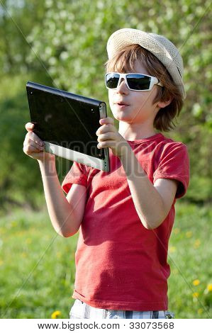 The Fair-haired Boy Plays In The Tablet Pc