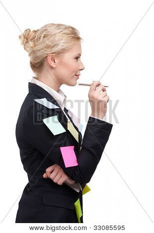 Young business woman in a black suit holding pen, isolated on white background