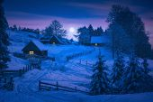 Rising Of Full Moon Over The Carpathian Village At Christmas Night. Fairytale Winter Valley. Happy N poster