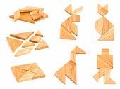stock photo of tangram  - Isolated views of wooden tangram with few finished figures - JPG