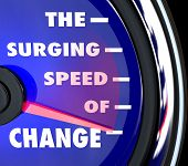 The words Surging Speed of Change on a blue speedometer with needle racing to represent the growing