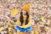 Playful Mood. Warm Woolen Accessory. Girl Long Hair Happy Face Fall Nature Background. Keep You Warm poster
