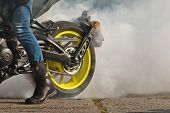 The Smoke Comes Out From Under The Wheels. Motorcycle Wheel Closeup. Smoke Due To Tire Rubbing Again poster