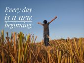 Inspirational Motivational Quote - Every Day Is A New Beginning. With Young Girl Standing In Wheat F poster