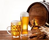 foto of beer mug  - Beer barrel with beer glasses on a wooden table - JPG