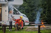 Summer Family Rv Camp. Father Having Fun With His Daughter In Front Of Campfire. Rv Class B Motorhom poster