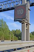 Electronic Speed Limit Sign Over Speed Highway. It Changes Value Depending On Weather And Road Condi poster