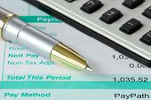 stock photo of summary  - ink pen calculator and payroll summary details - JPG