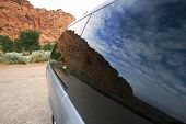 Reflection Of Skies With Redrocks On The Background - Travel Concept - Snow Canyon - Utah poster