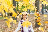 Melody Of Autumn. Falling Leaves. Happy Little Girl Wear Headphones On Autumn Landscape. Cute Child  poster