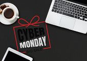 Top View Of Laptop And Cup Of Tea With Cyber Monday Lettering On Black Background. Copyspace For You poster