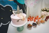 Very Beautiful Colorful Eye-catching Candy Bar With Cocktails And Sweet Unicorn Cake Pie. Pink Color poster