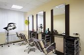 pic of barbershop  - Barbershop room with three working places in the beauty salon - JPG