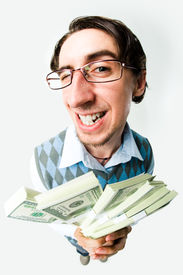 pic of holding money  - Photo of happy man holding packs of dollars in hands and looking at camera - JPG