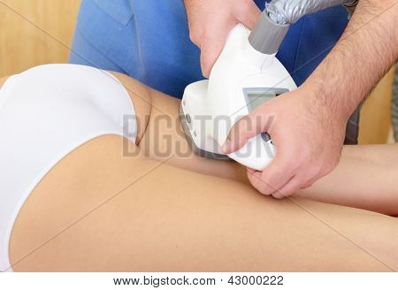 young woman getting anticellulite and anti fat therapy in beauty salon