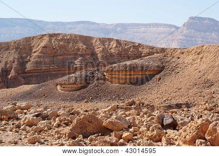 Scenic striped rocks in the Small Crater (Makhtesh Katan) in Negev desert, Israel