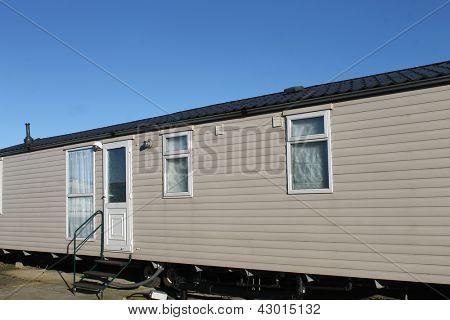 Exterior of trailer home in caravan park.