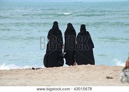 Group of arab women on the beach