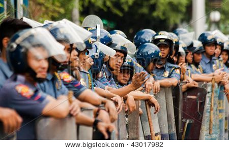 Riot police during International Women's Day protest
